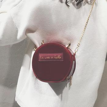 莫妮卡漆皮亮面链条斜挎包小圆包