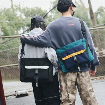 萨兰丹迪斜挎包男潮撞色邮差包女情侣百搭时尚单肩包