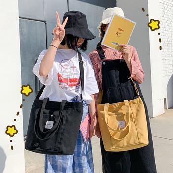 萨兰丹迪日系韩版文艺范女学生单肩包百搭帆布上课包