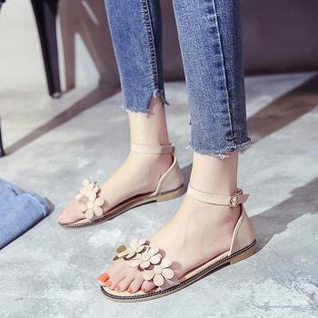 艾微妮韩版花朵装饰小清新平底休闲凉鞋
